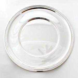 Salvamanteles liso fabricado en plata maciza de primera ley